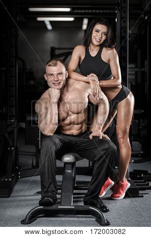 Sexy Caucasian Man And Woman In Gym .