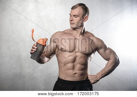 Brutal strong old bodybuilder man fitness male model posing in studio on white grey background topless body strong abs healthcare lifestyle