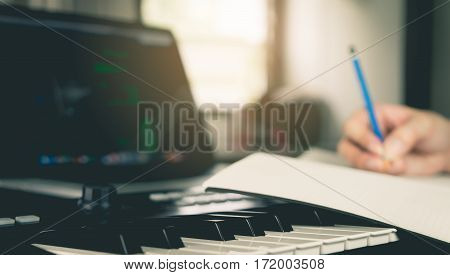 Musician writing a song into his blank book