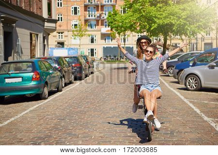 Vivacious Young Woman Riding On The Handlebars