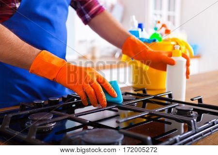 Man Makes Cleaning The Kitchen. Young Man Washes An Oven. Cleaning Concept.