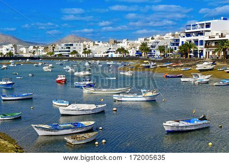ARRECIFE, SPAIN - NOVEMBER 11, 2016: A view of the bay Charco de San Gines and its characteristics fishing boats in Arrecife, Lanzarote, in the Canary Islands, Spain