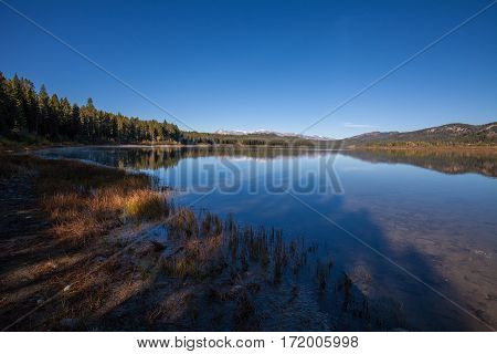 a scenic reflection in two oceans lake Teton National Park in fall