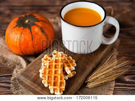 Mug Of Fresh Pumpkin Juice With Wafer And Pumpkin On Dark Wooden Table. Selective Focus.