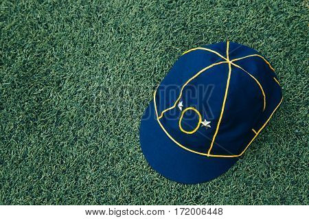 Used Hat Of Asian Boy Scouts On Lawn. Boy Scout Hat General Uniform.