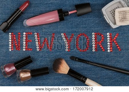 New York. World capitals of fashion. Word inlaid rhinestones and cosmetics. View from above