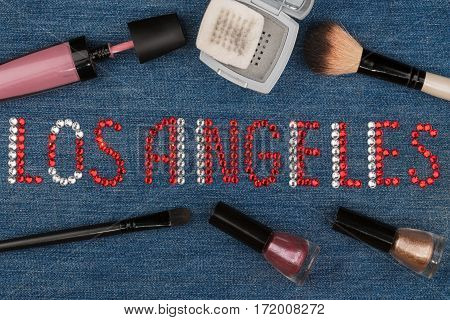 Los Angeles. World capitals of fashion. Word inlaid rhinestones and cosmetics. View from above