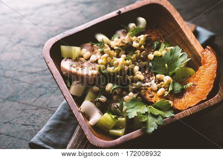 Baked spicy pumpkin with chicken and beans. Side view horizontal