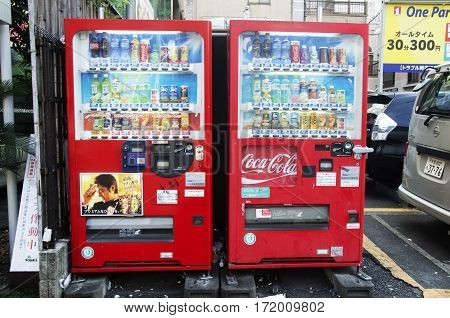 Red Vending Automatic Machine For People Buy Soft Drink At Pubic Park In Shinjuku City