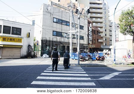 Japanese People Armored Guard Transporting Money Or Security Guard For Move Money In Shinjuku