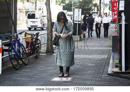 Traveler Thai Woman Shootin Photo Information Label On Ground At Pathway Beside Traffic Road At Shin
