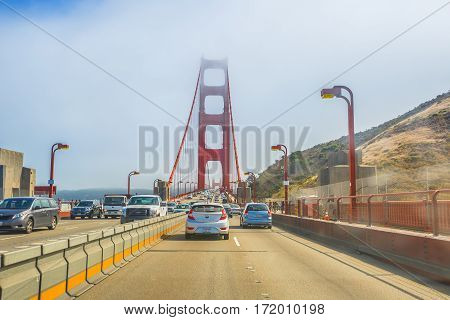 San Francisco, California, United States - August 16, 2016: point of view of car crossing Golden Gate Bridge from Presidio Pacific point to the north. In the traffic to and from the city.