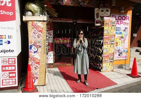 Traveler Thai Woman Stand And Posing At Front Of Local Shopping Mall In Shinjuku City