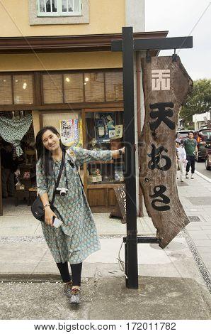 Traveler Thai Women Standing And Posing At Label Pole In Kawagoe In Saitama, Japan