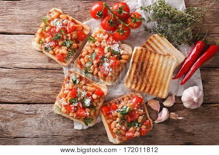 Tasty Sandwich With White Beans, Tomatoes, Cheese And Herbs Closeup. Horizontal Top View