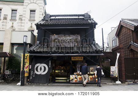 Japanese People And Foreigner Traveler Walking And Shopping Souvenir At Kawagoe In Saitama, Japan
