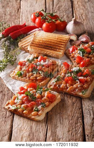 English Cuisine: Toast With White Beans, Tomatoes, Cheese And Garlic Close-up. Vertical