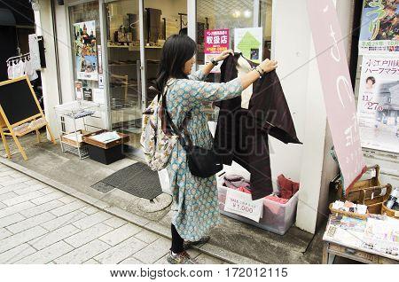 Traveler thai women shopping clothes japanese style on sale at local shop at Kawagoe or Kawagoe Little Edo in town of Kanto region on October 19 2016 in Saitama Japan