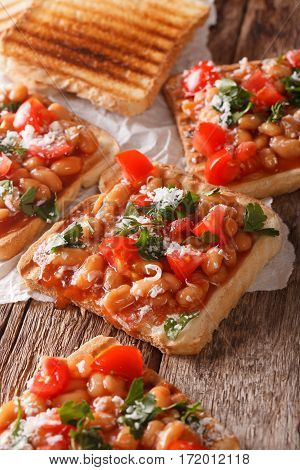 Toast With White Beans, Tomatoes, Cheese And Herbs Closeup. Vertical