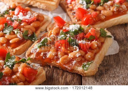 Toasts With Beans In A Tomato Sauce, Cheese And Herbs Macro. Horizontal