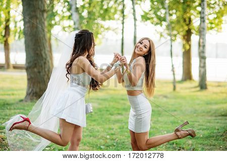 Two Friends Girls Having Fun On Park At Hen Party.