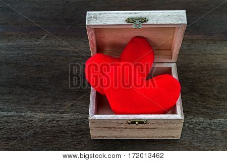 Valentines day background with handmaded hearts in wooden basket over wood. Top view with copy space