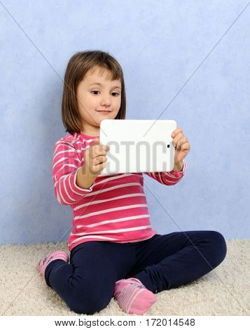 cute little girl with tablet