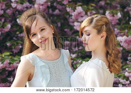 beautiful girls in the spring garden