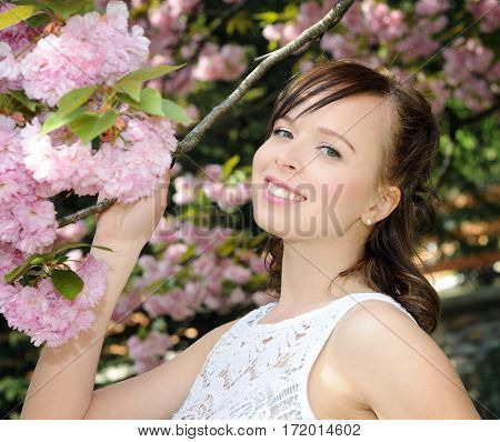 pretty girl in the spring garden