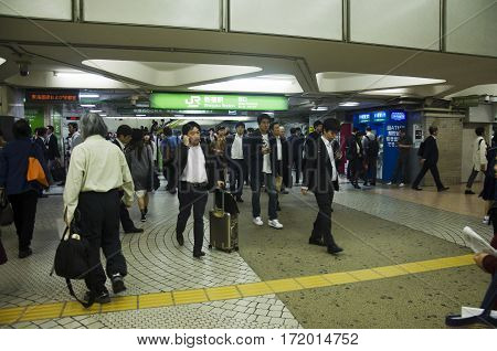 Japanese People And Foreigner Travelers Walking Entrance And Exit Gate For Passenger Train At Shinju