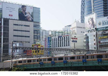 Cityscape And Jr Yamanote Line Of Train Tokyo Metro With Traffic Road At Shinjuku