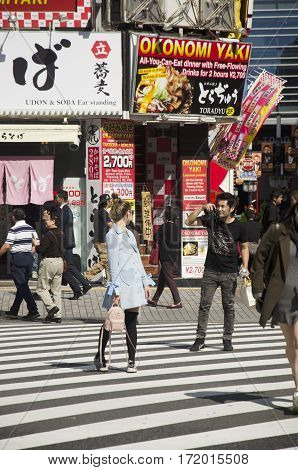 Japanese People And Foreigner Travelers Walking Crosswalk And Portrait For Shooting Photo On  Traffi