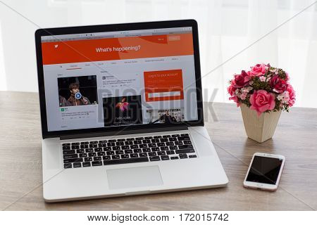 Alushta Russia - October 20 2016: MacBook and iPhone with social networking service Twitter on the screen. MacBook Pro and iPhone was created and developed by the Apple inc.