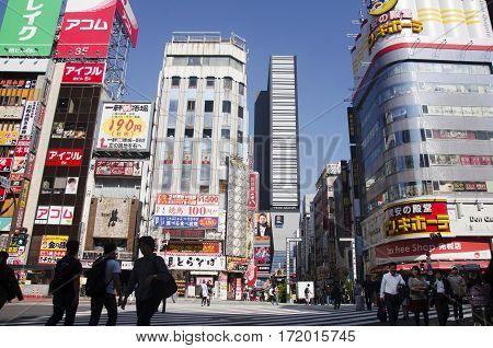 Japanese People And Foreigner Travelers Walking Crosswalk Traffic Road At Shinjuku