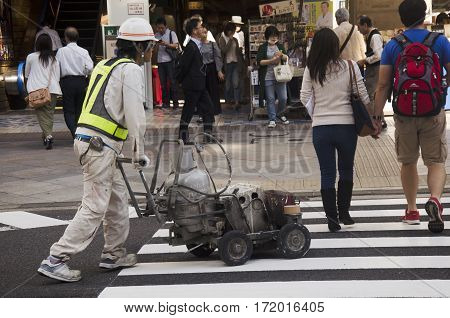 Japanese People In Construction Site Working And Repair Surface Of Road At Shinjuku