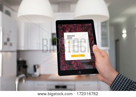 Alushta Russia - October 29 2016: Man hand holding iPad Pro Space Gray with app Home in the screen. iPad Pro 9.7 was created and developed by the Apple inc.