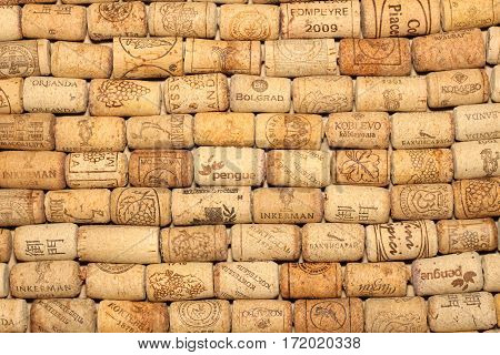 KIEV, UKRAINE - FEBRUARY 18 : Wine corks editorial background with dates and drops of wine on February 18, 2017 in Kiev, Ukraine
