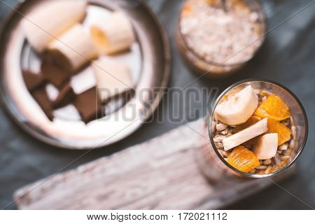 Smoothies and banana slices and biscuit on a tin plate horizontal