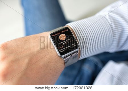 man hands smart touch watch with app tracking delivery package