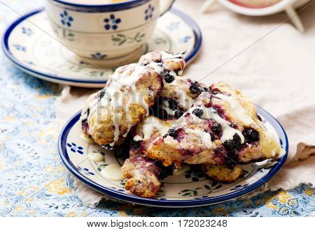 Blueberry scone with Cinnamon Cream Cheese Glaze.selective focus