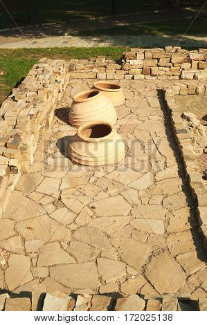 Large ceramic pots dug into the ground for the production of wine in Taman, Krasnodar region of Russia