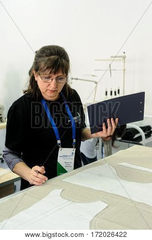 Tyumen Russia - February 17. 2017: Open championship of professional skill among youth World skills Russia Tyumen - 2017. The expert checks work of the tailor