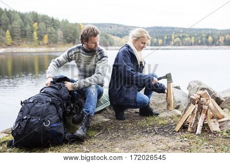 Couple Preparing For Camping On Lakeshore