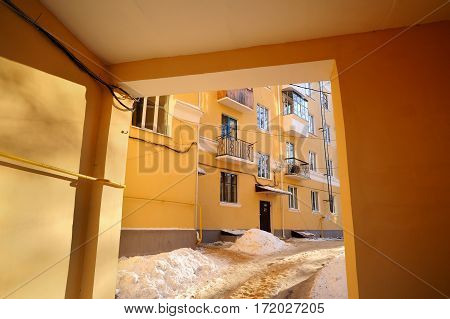 Sunlit backyard with opened square arch in winter season