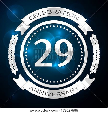 Twenty nine years anniversary celebration with silver ring and ribbon on blue background. Vector illustration