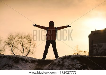 Woman On Top A Mountain With Arms Outstretched.
