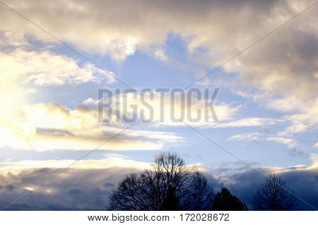 sunlight opposite the storm clouds day light