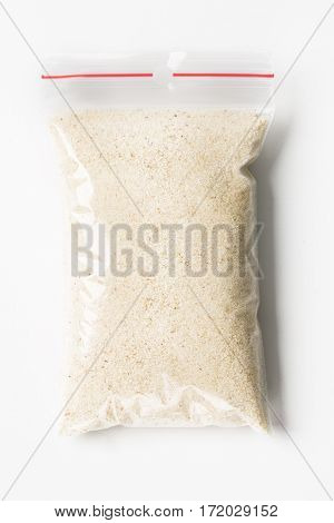 Plastic Transparent Zipper Bag With Full Dry Raw Wheat Semolina Isolated On White, Vacuum Package Mo