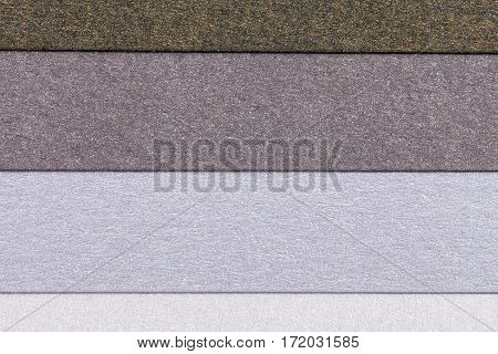 Background of colorful paper parallel horizontal shiny stripes.