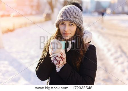 Cheerful Gorgeous Brunette In Winter Fashion Holding Disposable Cup On Winter Background